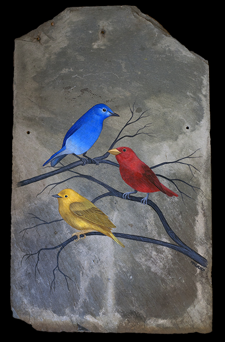 Blue bird, red bird, and yellow bird painted on slate roof